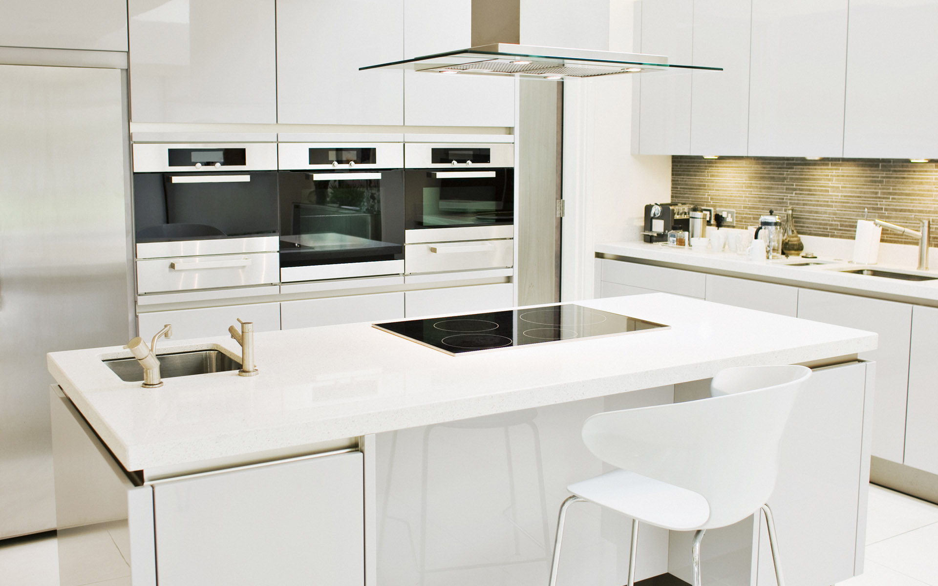 Modern White Kitchen Cabinets facing Amusing Counter plus Electric Stove and Tiny Barstools on Floor
