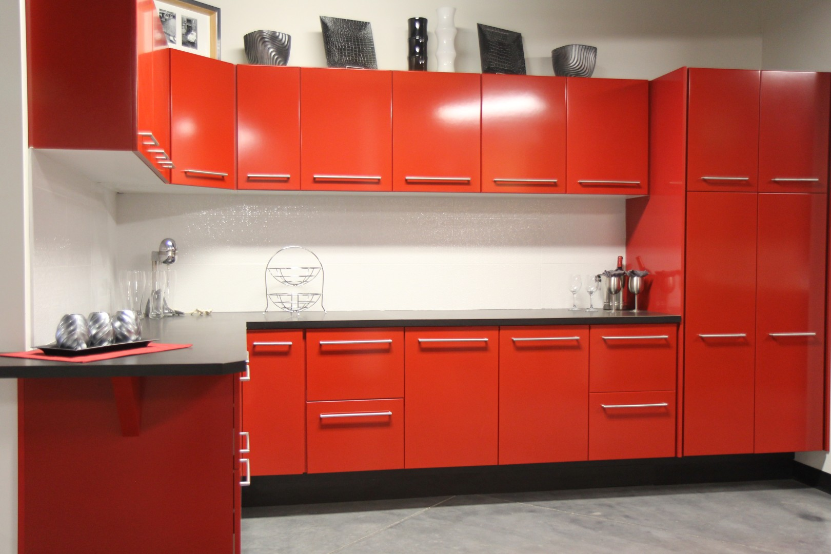 Delicate Design of L-shape Red Kitchen Cabinets with Sleek Countertop also Corner Sink
