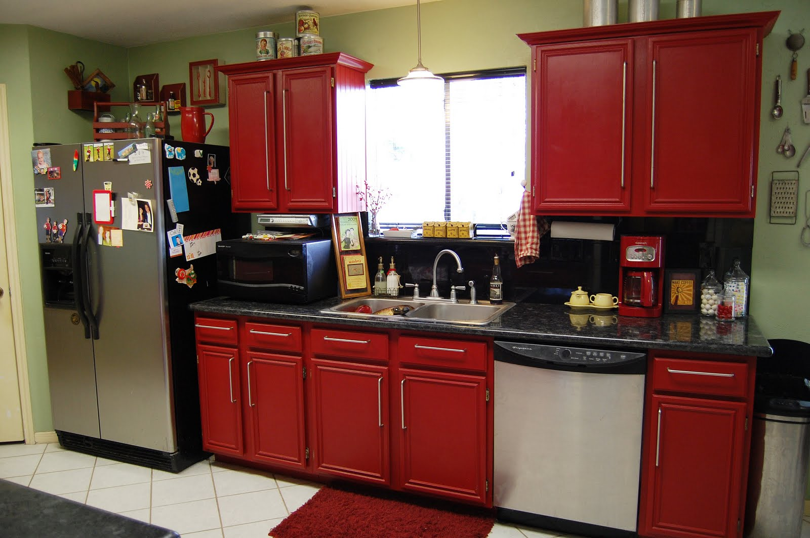Exquisite Interior Design with Red Kitchen Cabinets also Dark Countertop plus Good Backsplash