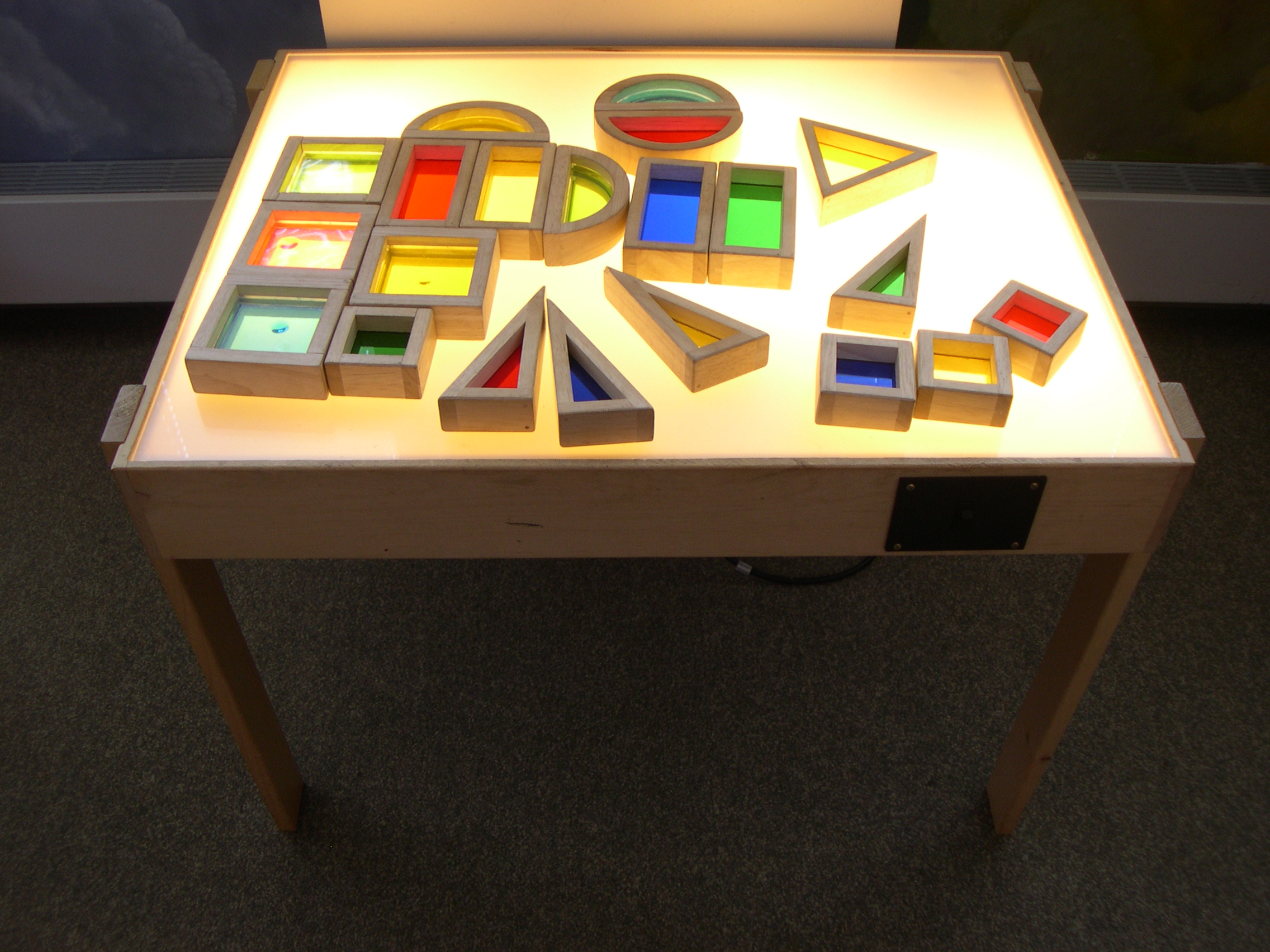 Colorful Ornaments on Simple Light Table with Wood Material and Minimalist Oak Legs